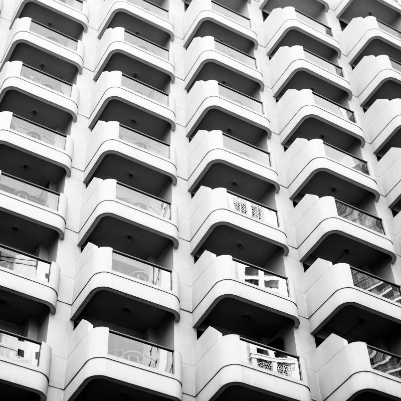 White condo Building with Balconies